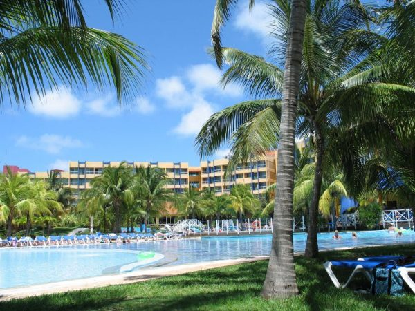 The pool, the resort, the palm trees